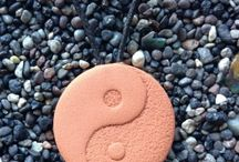 Terra Cotta Pendants /  Tip one drop of essential oil onto the surface of the terra cotta clay and enjoy your essential oil aroma wafting into your personal breathing space all day long! These are some of over eighty designs available.
