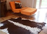 Rug Decor / Our cowhide rugs are so versatile, stylish and beautiful. They can go anywhere even the kitchen!