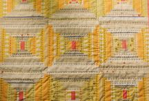 Yellow cabin fever / All shades of yellow, cream and soft grey with texture from blocks built in a log cabin style - whatever the shape: hexagon, square, triangle or rectangle.  Inspired by Mary Dugan's glorious yellow courthouse steps baby quilt