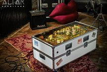 HOT TOUR Coffee Table / True to life flight case as built for real touring bands using Adam Hall parts! Original KISS backstage passes featured on the sides from the end of the seventies. These are in temporary positions, and can be changed according to your needs. You open up this darling, and gaze at the illuminated AF logo, and store your stash inside. The Hot Tour table rolls on it's wheels, and has four lighting programs. We will throw in a vintage KISS belt buckle and a few pins as extras, for the lucky buyer!