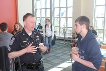 Coffee with a Cop / Coffee with a Cop is a international program that brings Officers and community members came together in an informal, neutral space to discuss community issues, build relationships, and drink coffee.   Coffee with a Cop is supported by The United States Department of Justice, Office of Community Oriented Policing Services. Similar events are being held across the county, as local police departments strive to make lasting connections with the communities they serve.  / by UNH Police