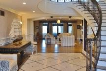 GRAND ENTRANCE PROJECTS / Client interior design projects in foyer and entry way of home featuring flooring, rugs, furniture and lighting.