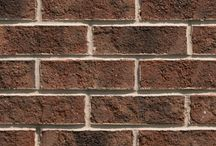 Hertford   Triangle Brick Company / If you're looking for an exterior cladding option that will make a truly bold statement, Triangle Brick Company's Hertford brick is a great choice. As one of our most striking bricks, the Hertford brick features a deep black walnut color with black flashing, providing a look for your building project that's just as classic as it is impressive. This stunning sand-faced brick is offered under our Standard product tier.