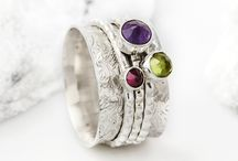 Spinning Rings / Charlotte´s Web offer the original and most extensive collection of handmade Silver Spinning Rings, ranging from simple silver spinner rings to ornate gemstone spin rings, each piece tells a story. Our sterling silver spinning rings are also often known as Meditation Rings and Motion Rings.