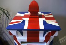 "Union Jack Post box mural / This postbox was crafted by a skilled carpenter who asked me to paint it with a union jack design. It was quite a fiddly project. No masking tape was used due to the complex nature of the mouldings. I elected to use a "" brush rule"" technique which was an old school skill that I learnt many years ago at art college. This technique is still practiced by some sign writers and coach painters using a long thin coach brush to paint the lines."