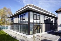Zurich Animal Protection office / The glass facade of the Zurich Animal Protection office with 1'400 m2 of laminated SEFAR® Architecture VISION Fabric provides an ideal habitat for animals and humans alike. Externally, the surroundings flow into the building.