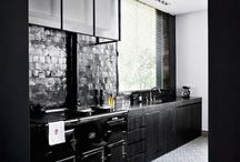 Spaces.Kitchens | Modern + Masculine / Clean lines & minimal ornamentation are a perfect match with simple materials such as hand-glazed tile, honed marble, white oak and blackened steel.
