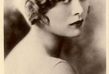 Flapper Chic / I'm looking at antique flapper dresses and 20s hairstyles for inspiration as I finish the first round of edits on my forthcoming novella Midnight In Your Arms, an eerie Halloween romance for Avon Intrigue! My heroine, the sexy psychic time-traveller Laura Dearborn would definitely vamp it up in these sumptuous Deco frock and hairstyles.