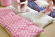 Camas con almohadas