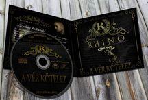 Rhino Zenész Nagy-Arculat / Rhino Music Home RHINO becsületes nevén Balogh Edvárd; egy komáromi Rap zenész és előadóművész. Hosszú éveken keresztül a Real Trill Music lemezkiadó cégnél dolgoztunk együtt, természetesen én Webmesterként. Szóló karrierje kezdetén felvettünk egy szorosabb kapcsolatot és így készült el egy fekete alapon aranyozott patinás honlap melyhez zenészi nagy-arculatként készült CD borító terv és névjegykártya, polótervek és borítókép.
