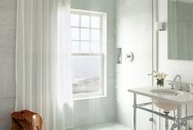 Window coverings for windows in showers