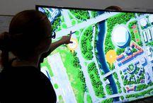 Interactive and multimedia models. Интерактивные и мультимедийные макеты / Интерактивный макет позволяет максимально просто донести идею до целевой аудитории и дает возможность подать проект, даже если он находится на стадии планирования и проектировки. Макет имеет высокотехнологичную часть - мультимедийную панель, на которой транслируется изображение. В отличие от обычного макета, интерактивный позволяет включить больше эмоциональных элементов и привлекает внимание посетителей за счет оригинальной формы подачи проекта.