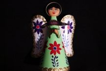 Painted Tin Angel Figurine II MD / This beautiful painted angel makes a great gift or an attractive display for your own home. Each tin angel is hand cut and painted one at a time by Mexican metal craft artisans.