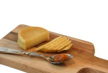 "Our Cheeses / ""Give me a good sharp knife and a good sharp cheese and I'm a happy man."""