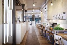 Interior / bulbs by Plumen; bar from tiles; flowers in the sink; table from the tiled oak