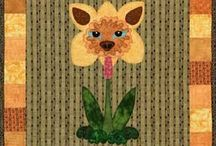 Dogs and Flowers / These amazing pups are showing their petals. These dog quilt patterns are perfect as a wall decoration or a bed quilt.