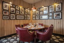 Graze Bristol / A refinement of the original Graze chophouse concept, to elevate the experience in line with the new brand values established at Bath. Feature details are bandsawn oak wall planking, cast concrete Hungarian tiles and butchers imagery.