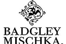"""Badgley Mischka / Badgley Mischka is an American fashion label designed by Mark Badgley and James Mischka. Badgley Mischka's looks are described as """"red-carpet-destined evening wear"""" but generally produced with lighter fabrics and less construction. They are also known for fragrance, handbags, shoes and eyewear."""