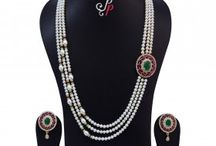 Stylish and Rich Pearl Set in Red and Green Stones Pendant at Rs. 12,900