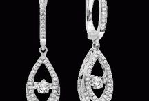 The Rhythm of Love Collection / This is truly an amazing diamond collection where the diamond never stops moving! The diamond dances inside the setting. From every angle light is reflected creating an amazing sparkle and scintillation.