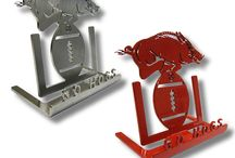 Arkansas Razorbacks / Metal art products for Arkansas Razorback fans! See our business card holders, Christmas ornaments, grill rack, license plate tags, phone stands, trailer hitch covers, trivets, wall decor and yard signs. Each product is made from quality stainless steel or powder coated in Razorback red. These high quality items make great gifts for Hog fans and University of Arkansas Alumni. Perfect gift ideas for Christmas, birthdays, graduation, Mother's Day or Father's Day. Wooo Pig Sooie!