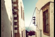 Local architecture of Patmos / Whitewashed, stone-built houses with colorful windows and doors, and blue domed churches abound in the two traditional settlements of the island, Skala and Chora of Patmos. http://goo.gl/WRwfuZ