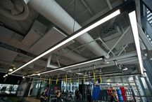 Fitness First Market Street Sydney / Austube's high performance AUS 50 Greenstar LED are featured prominently in the latest Fitness First fit out located in Market Street Sydney. LED was chosen based on its high perfomance and significant environmental benefits.  Beautiful continuous lines resinate throughout the gymnasium.    A Black extrusion was chosen to compliment the industrial-style ceilings, and fittings are wire suspended to harmonise with the exposed services.