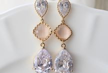"Lovely earrings / Lovely faceted diamond peach champagne glass and crystal clear cubic zirconia earrings set in shiny gold tone and measures 2"" long. Each piece will arrive in a box tied with a ribbon perfect for gift giving."