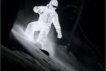 snowboard / sliding downhill on snow