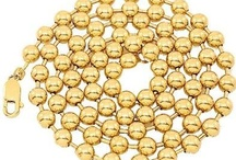 Ball Chain / A Ball Chain is a string of tiny metal balls connected with a metallic wire. The look achieved is similar to that of a beautiful string of pearls. The metal balls substitute for the pearls in a ball chain.