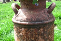 large antique metal milk jug.