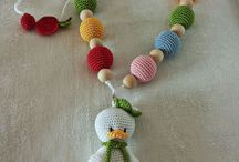 Breast-feeding / nursing necklace / Breast-feeding/nursing necklaces are necklaces to wear when you breastfeed in order to facilitate and prolong lactation capturing the attention of the child. The necklaces are made up of simple and coated wood beads, beads are coated with cotton or lisle thread.  Colorful and fun are a unique toy for your child and a beautiful accessory for the mom wearable not only for nursing.