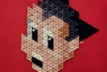 Pixel Icons / This collection of folded paper and sewing threads 3D wall sculptures pays tribute to both 8-Bit videogames and famous characters from 80s / 90s Pop Culture.