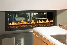 Sleek and Modern Fireplaces / Envision a fireplace that takes your breath away with no screen - just fire! Picture a gorgeous eye-catching flame sitting directly beneath your television ...  these sleek and modern fireplaces were designed for you.