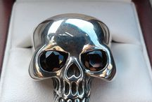 """Skull Ring Momento Mori by 3signets / Skull Ring Solid .925 Stirling Silver Hall Marked set with 2 Garnets for the eyes. Total weight of garnets is 1.1 carets.   This is a high quality stunning head turning Product. Hand finished.   A heavy Solid Ring that turns heads and makes a statement.   Comes in a Quality Presentation Box.   Skull Rings and Jewelry have a history  Memento mori - that is Latin: """"remember that you must die"""" is the medieval Latin theory and practice of reflection on mortality. Value the time we have."""