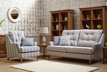 Hemsby Upholstery / A Sofa Collection featuring Button Back cushions, low wing arms and turned wooden feet.