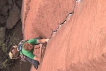 Crack Climbing / Crack Climbing (noun):  The technique and process of ascending various sized cracks or fissures that split rock faces. Progress is made my jamming or wedging a climber's fingers, hands, arms, feet, and legs into the crack, depending on its width. Cracks are often described by the appendage used to climb it, such as a hand crack, fist crack, or finger crack. Wide cracks are called off-width cracks and chimneys.