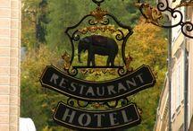 Signs for hotels, restaurants, shops