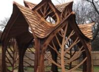 Tree style wood sculptures shelter