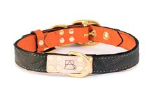 The Orange Collection + Inspiration / These electric orange dog collars are not for the faint of heart. Perfect for the pup who's looking to add a little color to their life. Featuring the leather from reclaimed cowboy boots, brass plated hardware, laser etched details, hand painted edges, and custom stitching. Each dog collar comes with a genuine, brass plated Boots & Arrow tag.