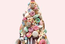 Croquembouche Cakes / Our Croquembouche Cake: glazed filled choux buns and eclairs, baked buttermilk doughnuts, macarons, candied popcorn, ice-cream cones, Ferrero Rochers, piped buttercream flowers, and real sponge cake layers, frosted with Swiss meringue buttercream and glazed in Belgian chocolate.