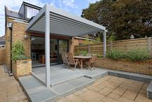 Creative side glass roof & rear roof kitchen extension in Teddington