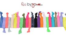 Rio by Jozemiek Hairties and bracelets . You shop, We Donate ! / 9 colourfol sets of 5 pieces. Buying 1 set provides a meal for a streetchild in Rio.You shop, We Donate