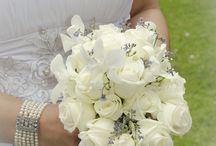 Bridal bouquet with white dendrobium orchids and forget-me-nots.