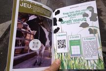 Gratt'Meuh - Le fake devenu réalité / Devant le succès planétaire du fake tourné chez eux (65 000 vues sur Youtube pour la vidéo des vaches QR Codées), Gaëlle et Fabrice Ménard ont décidé d'utiliser « pour de vrai » les QR Codes dans leur ferme située à Séné dans le Golfe du Morbihan.  Ainsi, depuis le 1er mai 2012, les randonneurs qui longent l'exploitation sont invités à flasher les colliers QR Codés portés par leurs vaches pour jouer au Gratt'meuh, jeu de grattage (type morpion) développé par bookBeo.