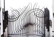 Forged metal: architectural blacksmithing / Forged metal attached to buildings. Blacksmith, blacksmithing, handforged, gates, railing, porch rail, hand rail, stair rail, interior rail, exterior rail, door pulls, handles, door knockers, window grills, decorative grills, hardware, hinges, latches.