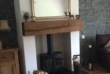 Oak Mantles / We get many requests from clients for oak and pine beams, in this case our client chose to use an oak beam as a mantle above their wood burning stove. Bow ties were used to ensure the crack did not spread as the client felt it gave the beam more character. It was then finished with a rugger brown stain wax.