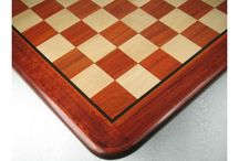 Bud Rose Wood Chess Boards - chessbazaar.com / These chess boards are made from the bud rosewood. Bud rosewood is more expensive and rare type of rosewood. It has a wine-red deep color interlaced with orange grains. The chess boards made from the bud rosewood also have a unique natural look. These chess boards are beautifully hand carved by the craftsmen. The underside of the board is filled with green velvet.  Our bud rosewood chess board range includes wooden chessboard blood red bud rose wood in different sizes.