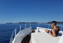 Our daily boat trips / If you come to explore Sardinia, the pearl of the Mediterranean, don't miss this great opportunity to pass by Alghero, the Capital of the Coral Riviera, and join us for a memorable boat trip around the Gulf of Alghero! On our trip you will have a chance to enjoy the beauty of Capo Caccia vertical cliffs, turquoise waters of the coves in Porto Conte or just relax and take the sun. We also offer you refreshing drinks followed by full lunch. All this and much more for a reasonable price!