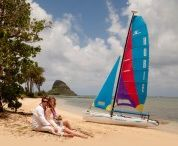 Catamaran Weddings / Perhaps you're looking for a wedding in Hawaii that is completely off-the-charts!. If so, picture yourself aboard a private catamaran with beautiful rainbow colored sails, cruising off with Capt. Howie for a very secluded Hawaii beach wedding... perhaps on a tiny offshore island.